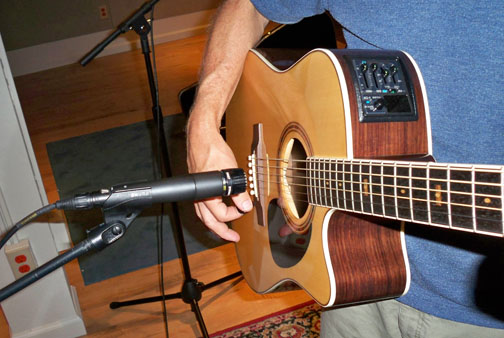 We started with the SM-57 directly over the sound hole and about 4 inches away from the guitar face. 