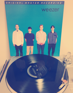 The Blue Album by Weezer pressed on vinyl.