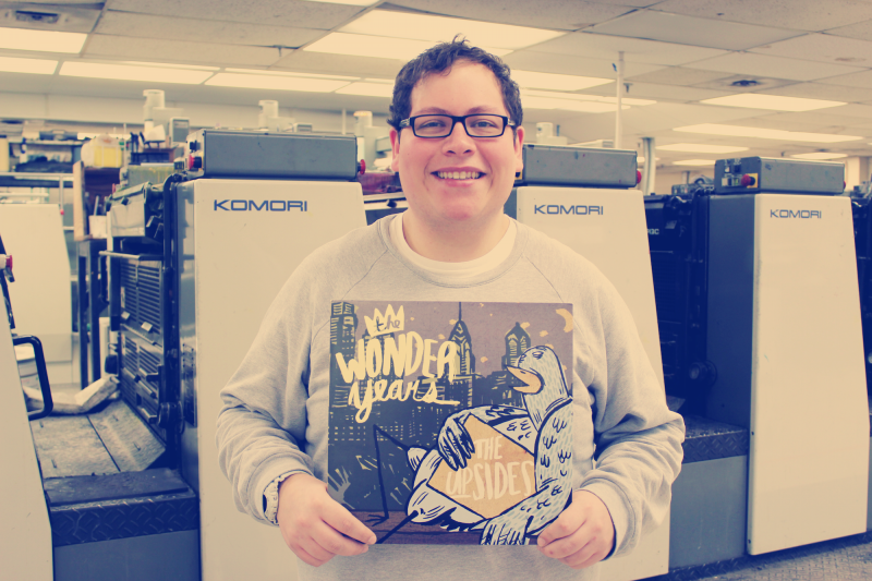 Jake Slater holds up a copy of The Wonder Years on vinyl.