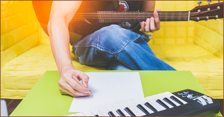 A musician writing in key changes and modulations to spice up a song.