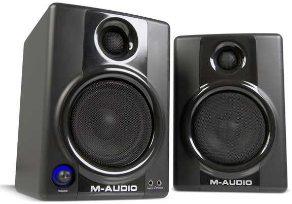 Another good choice are the M-Audio series of small powered monitors, the DX-4 system mentioned by Richie is being replaced by the new AV 40 system at the same price point.