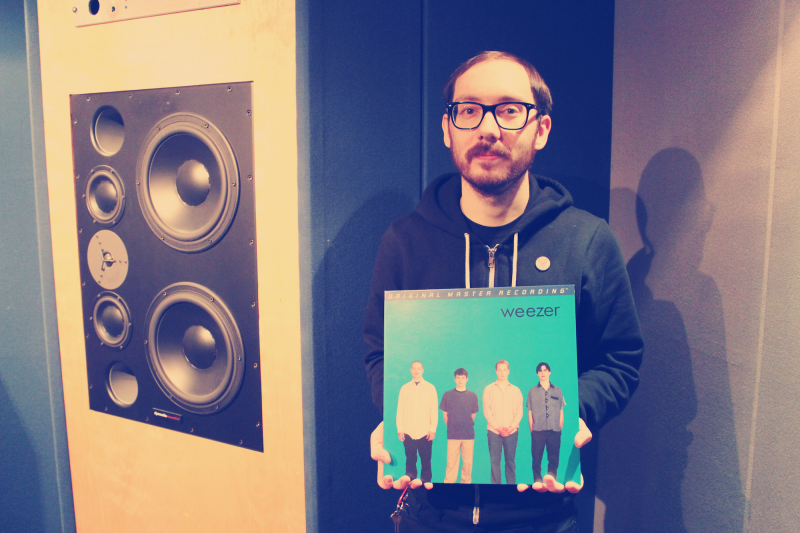To show his love of vinyl records, Dan Saraceni displays his copy of The Blue Album by Weezer.