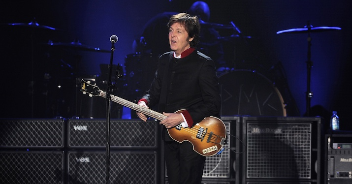 Paul McCartney playing his bass guitar