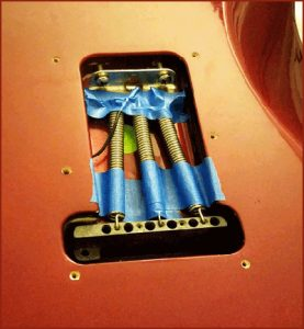Tremolo springs being muted to improve guitar tone for recording